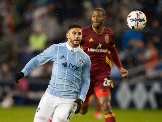 Sporting Kansas City forward Dom Dwyer (14) chases down the ball in front of Real Salt Lake's Chris Shuler during the first half of an MLS soccer match Saturday, April 29, 2017, in Kansas City, Kan. (Nick Tre. Smith/The Kansas City Star via AP)