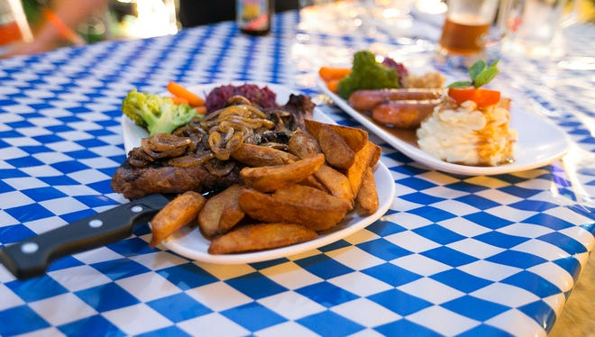 Food specials during the Oktoberfest celebration at McKraut's Bar and Restaurant in Maloloj are shown in this 2015 file photo.
