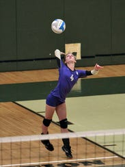 Fowlerville's Sara Domine serves during Tuesday's scrimmage