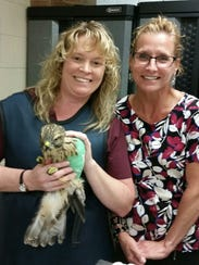 Dr. Jennifer Johnston (left) a staff veterinarian at