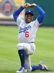 Dodgers' Curtis Granderson warms up in the outfield
