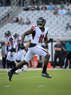 FILE - In this Aug. 25, 2018, file photo, Atlanta Falcons wide receiver Julio Jones (11) warms up before an NFL preseason football game against the Jacksonville Jaguars, in Jacksonville, Fla. On the eve of training camp, the Falcons worked out an adjustment to Jones' contract and promised to negotiate a new deal in 2019. They knew there was no way to contend for a Super Bowl title without No. 11. (AP Photo/Phelan M. Ebenhack, File)