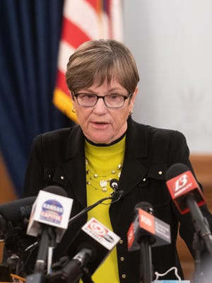 Gov. Laura Kelly talks to the media during a news conference Monday at the Kansas Statehouse. She urged Kansans to wear masks amid a steep increase in new COVID-19 cases in the state.