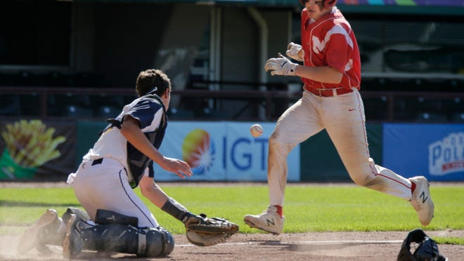 Mount St. Charles' Trey Bourque comes in to score after the ball pops from the glove of waiting Barrington catcher Jack Kriz during the Division II  Finals in baseball in June 2019 at McCoy Stadium. The Mounties won the championship that day.