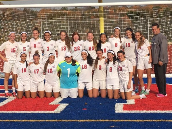 Carmel's girls soccer team poses after defeating visiting White Plains 5-0 in a Section 1 tournament outbracket game on Thursday, October 22nd, 2015.