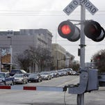 Traffic waits for a train to pass on North Main Street in downtown Hattiesburg on Wednesday.