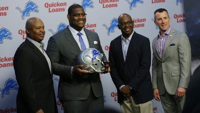 Laken Tomlinson is introduced as the Detroit Lions 2015 first-round draft pick during a press conference at the Detroit Lions practice facility in Allen Park  on Thursday, April 30, 2015.From left to right are head coach Jim Caldwell, Laken Tomlinson, general manager Martin Mayhew and president of the Detroit lions Tom Lewand.