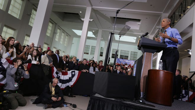 The crowd listens to President Obama deliver remarks at UAW-GM Center for Human Resources , the national headquarters of the joint relationship between UAW and GM during his visit to Detroit on Tuesday, Jan. 20, 2016.