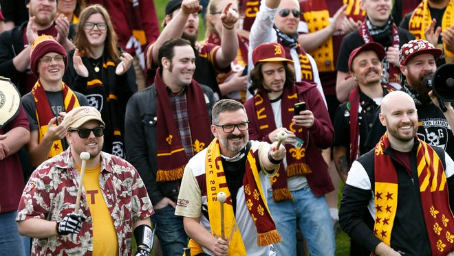 Detroit City FC fans cheer for their team as they play the Michigan Bucks on Wednesday, May 11, 2016, at Oakland University in Auburn Hills.