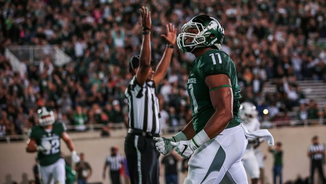 Michigan State Spartans tight end Jamal Lyles celebrates his fourth-quarter touchdown against Furman during the opener at Spartan Stadium in East Lansing, Michigan, on Friday, September 2, 2016.