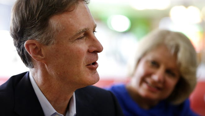 Evan Bayh, the former two-term governor and two-term senator, speaks in July about why he has decided to seek re-election to the U.S. Senate. His wife, Susan, looks on.