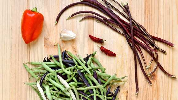 Clockwise, from top left: Red bell pepper, Chinese red noodle beans, green beans, garlic and dried chili peppers, part of a CSA share from Prescott's Patch.