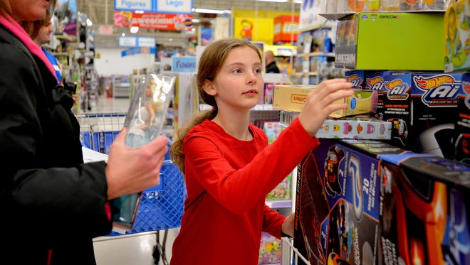 """Mallory Rhinehardt, 9, of New Milford, with her mother, Karla, shopped in Toys """"R"""" Us on a shopping spree courtesy on Wednesday, Dec. 7, 2016."""