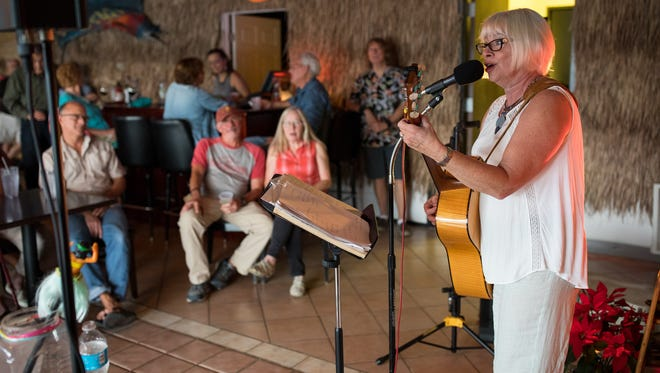 Carol Elliott performs at Giggity's Tiki Room in Port Aransas on Friday, Feb. 10, 2017. Elliott was diagnosed with breast cancer shortly after getting insurance through the Affordable Care Act.