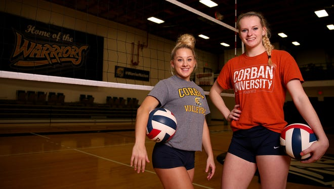 Madison Milligan, left, a junior setter, and Beth Filipenko, a senior right side hitter, with the Corban University volleyball team in Salem on Nov. 8, 2017.