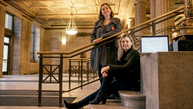 """University of Michigan juniors Griffin St. Onge, right, and Lauren Schandevel pose for a photo at Angel Hall on the U-M Ann Arbor campus on Wednesday April 19, 2018. They wrote the online publication, """"Being Not-Rich at UM."""""""
