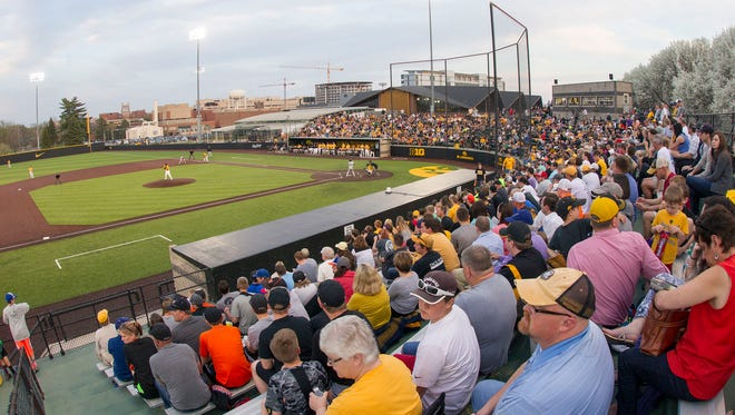 Baseball fans enjoy the Iowa vs. Northwestern game at Duane Banks Field on Friday.