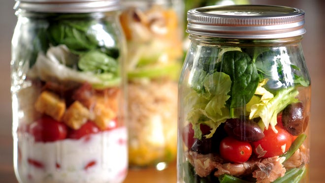 Creating a layered salad in a sealed jar makes for a delicious, portable lunch.