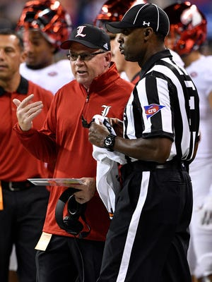 Sep 2, 2017; Indianapolis, IN, USA; Louisville Cardinals head coach Bobby Petrino talks with an official during the second quarter against the Purdue Boilermakers at Lucas Oil Stadium. Louisville defeated Purdue 35-28.  Mandatory Credit: Jamie Rhodes-USA TODAY Sports