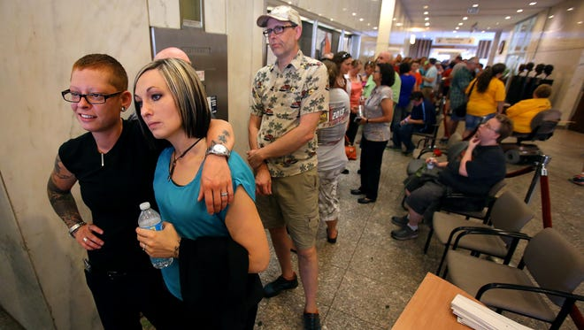 Traci and Leanne van de Bossche waited in line for over two hours on June 25, 2014, to receive their marriage license at the Marion County clerk's office inside the City County Building in Downtown Indianapolis, after a federal judge ruled Indiana's ban on gay marriage was unconstitutional.