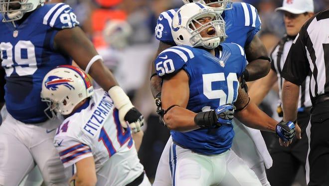 Colts linebacker Jerrell Freeman screams after sacking Buffalo quarterback Ryan Fitzpatrick in the first half on Sunday, November 25, 2012 at Lucas Oil Stadium. The Colts won 20-13. (Matt Detrich / The Star)