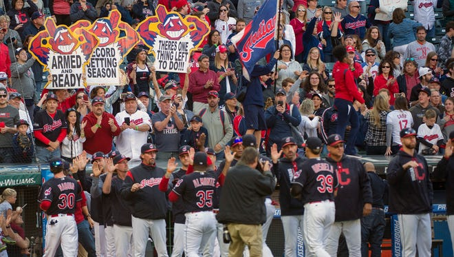 Cleveland Indians fans celebrate victory No. 102 last year and held up signs that helped usher in a short-lived post-season.