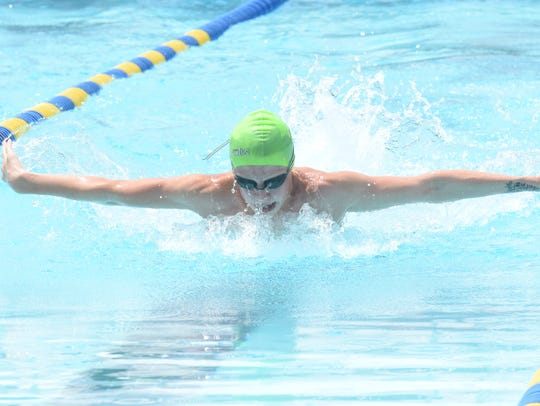 Mountain Home's Micah Cruse competes in a butterfly