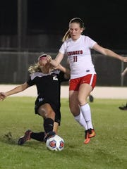 Mariner's Karleigh Acosta slides in to take the ball from North Fort Myers' Taylor Metzger.District 3A-13 girls soccer championship game between Mariner and North Fort Myers. Fort Myers won 1-0.