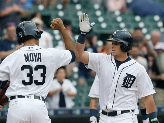 James McCann is greeted at home by Steven Moya after