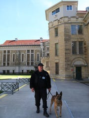 Senior correctional officer Mike Barnes makes rounds with his Belgian Malinois, Thor, inside the current Iowa State Penitentiary in Fort Madison.