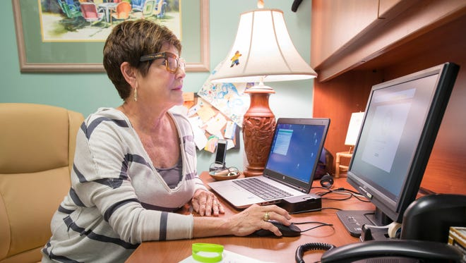 Paula Doty, prevention coordinator at Gulf Coast Kid's House, works in her office on Tuesday, June 27, 2017.