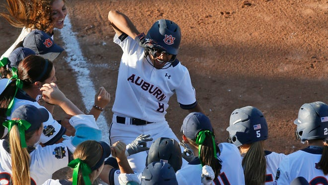 Auburn first baseman Jade Rhodes (8) celebrates her home run over Florida State in the third inning of a Women's College World Series game in Oklahoma City, Sunday, June 5, 2016. (AP Photo/Sue Ogrocki)