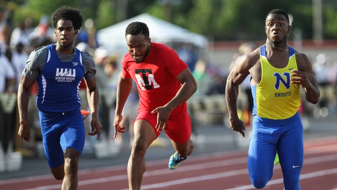 Northwest's DeVohn Jackson (right) easily wins the 100-meter dash at the Division I regional finals at Welcome Stadium.