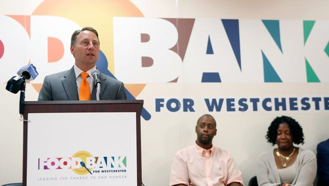 """Westchester County Executive Rob Astorino addresses press conference attendees to kick off """"Go Orange to End Hunger month at The Food Bank for Westchester in Elmsford on Thursday, September 08, 2016."""