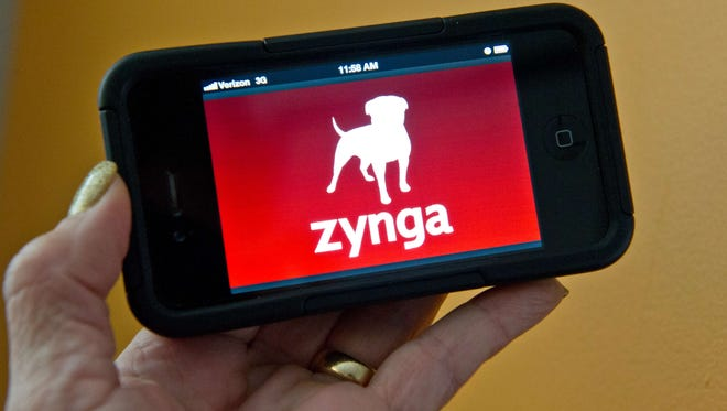 This January 6, 2014 photo taken in Washington, D.C., shows the logo for the online gaming company Zynga.
