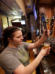 Bartender Alexis Johnson draws a Deschutes beer for