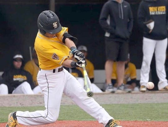 Alex Schutz gets a hit while playing for St. Bonaventure.