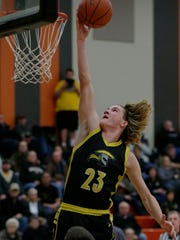 Waupun's Reece Homan goes in for a layup during a Jan. 12 game against Ripon.