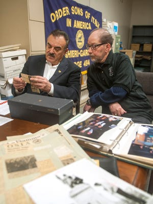 Members of the Alighieri-Garibaldi Lodge 494 of Westmont, Order Sons of Italy, Dominic Pucci of Collingswood, left and Frank Nardi of Pennsauken visit the Courier-Post's library to view archival photographs and articles while researching their lodge's history is preparation of the 100th anniversary celebration of the lodge in April.  03.11.16