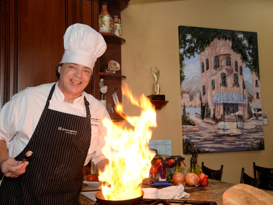 Showing his flair for flambé, Chef Woody Kerr of Kitchen Kitchen in Indian Wells demonstrates how to prepare mushrooms and onions with a touch of flaming brandy.