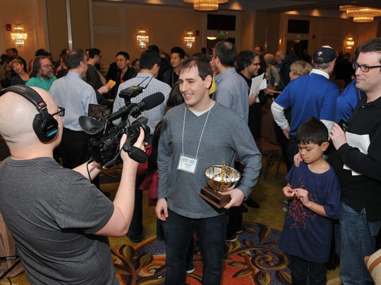 Howard Barkin of Hillsborough is interviewed after winning the American Crossword Puzzle Tournament on April 3 in Stamford, Connecticut.
