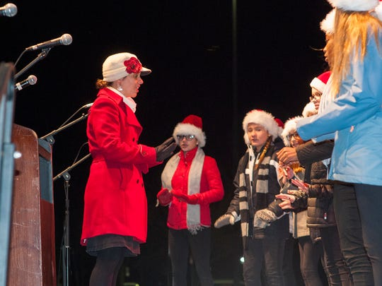 The choir from Discovery Middle School, under the direction of Bridgit Cook, provided holiday carols while families waited for Santa's arrival.