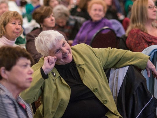 Pat Hutchison listens to Denise Kiernan's talk at the last Livonia Town Hall of the season.