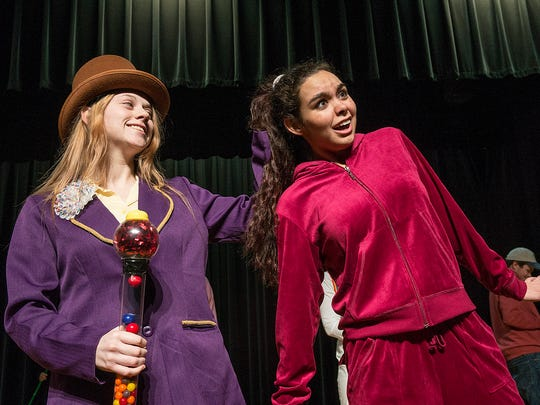 Willy Wonka (Jacquelyn Schlicht) yanks Violet Beauregard's (Payton Kilgore) hair.