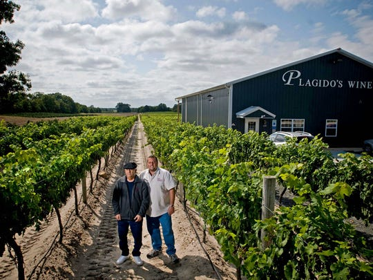 Plagido's Winery owner Ollie Tomasello Sr., left, and