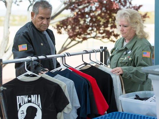 U.S. Army veteran Armando Sanchez looks at military shirts for sale on Saturday, March 31, 2018, during the eighth annual Welcome Home Vietnam Veterans event at Veterans Memorial Park.