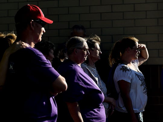 Cancer survivors prepare to walk to the track for their first lap during the Relay for Life event held at River Valley High School on Friday evening.