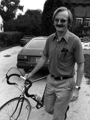 Donald Kaul pictured with his bicycle in 1979.