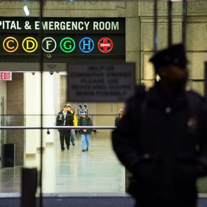 A New York City Police officer stands at the entrance to Bellevue Hospital October 23, 2014, in New York City.