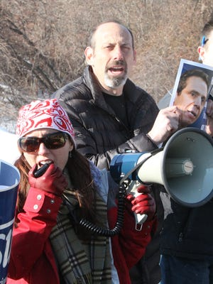 Nyack High School teachers Adele Metrakos and Josh Weinman participate in a protest at the school against Gov. Andrew Cuomo's schools budget and other education reforms Monday.